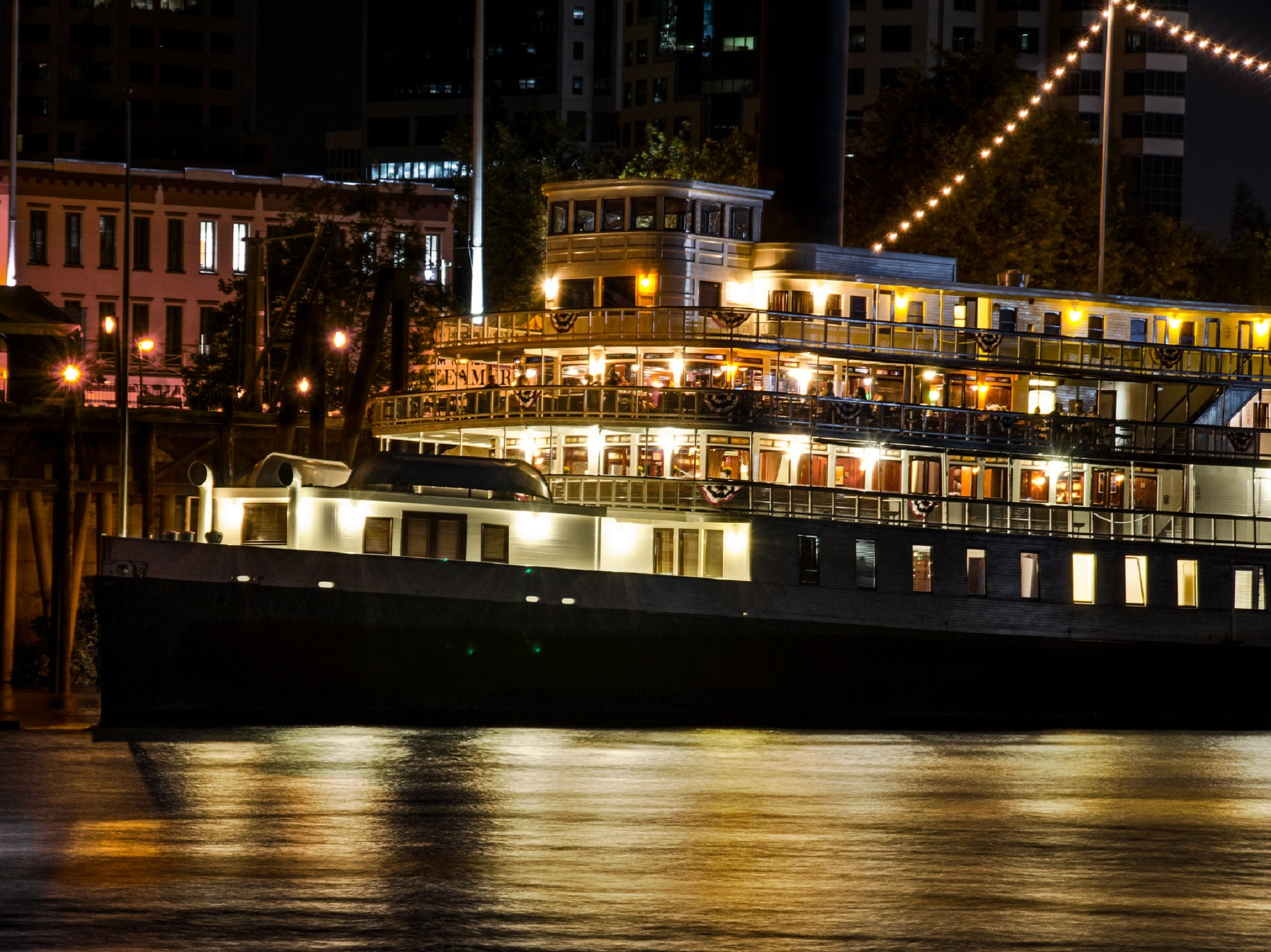A paddle wheel boat in the delta at night