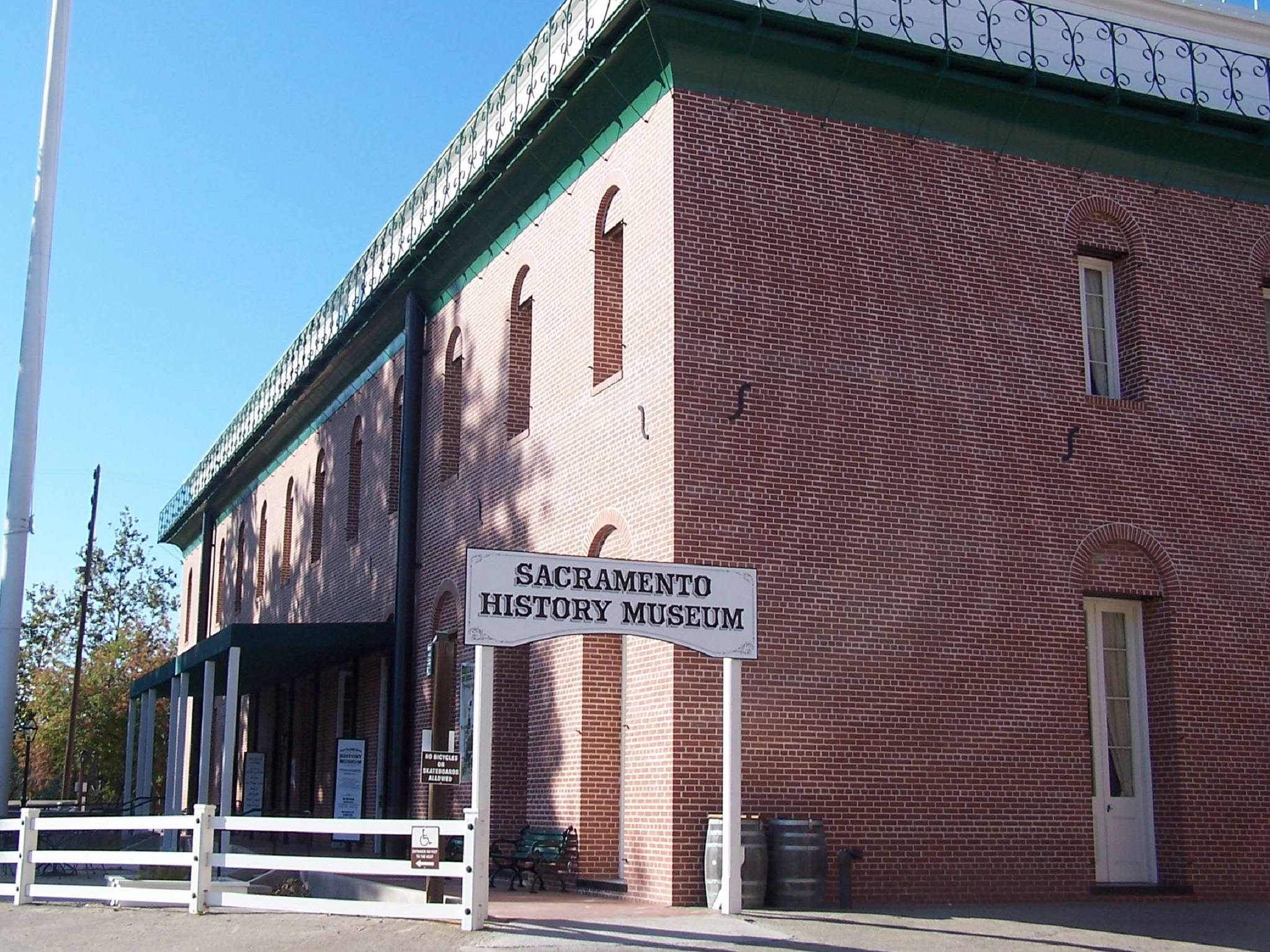 The outside of the brick museum with a wooden sign