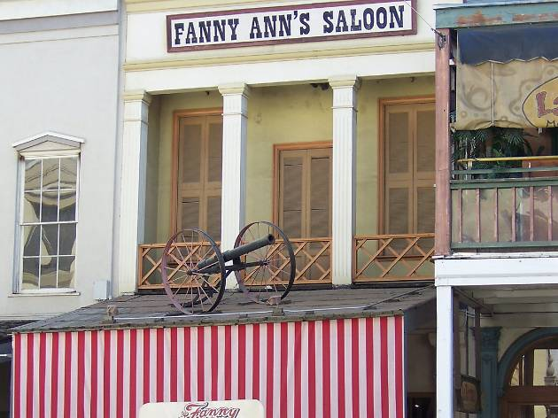 The striped awning with an antique canon as part of the Fanny Ann's storefront