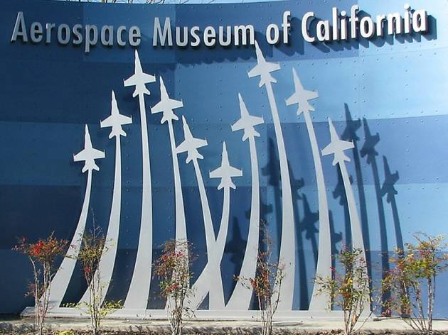 A sign with the outline of several planes soaring