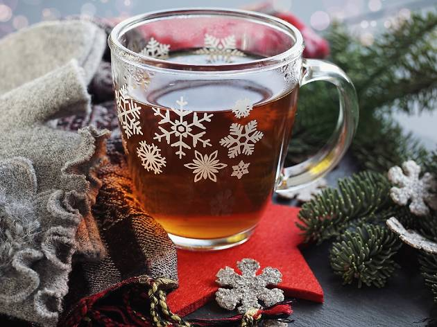 A holiday mug with liquid inside