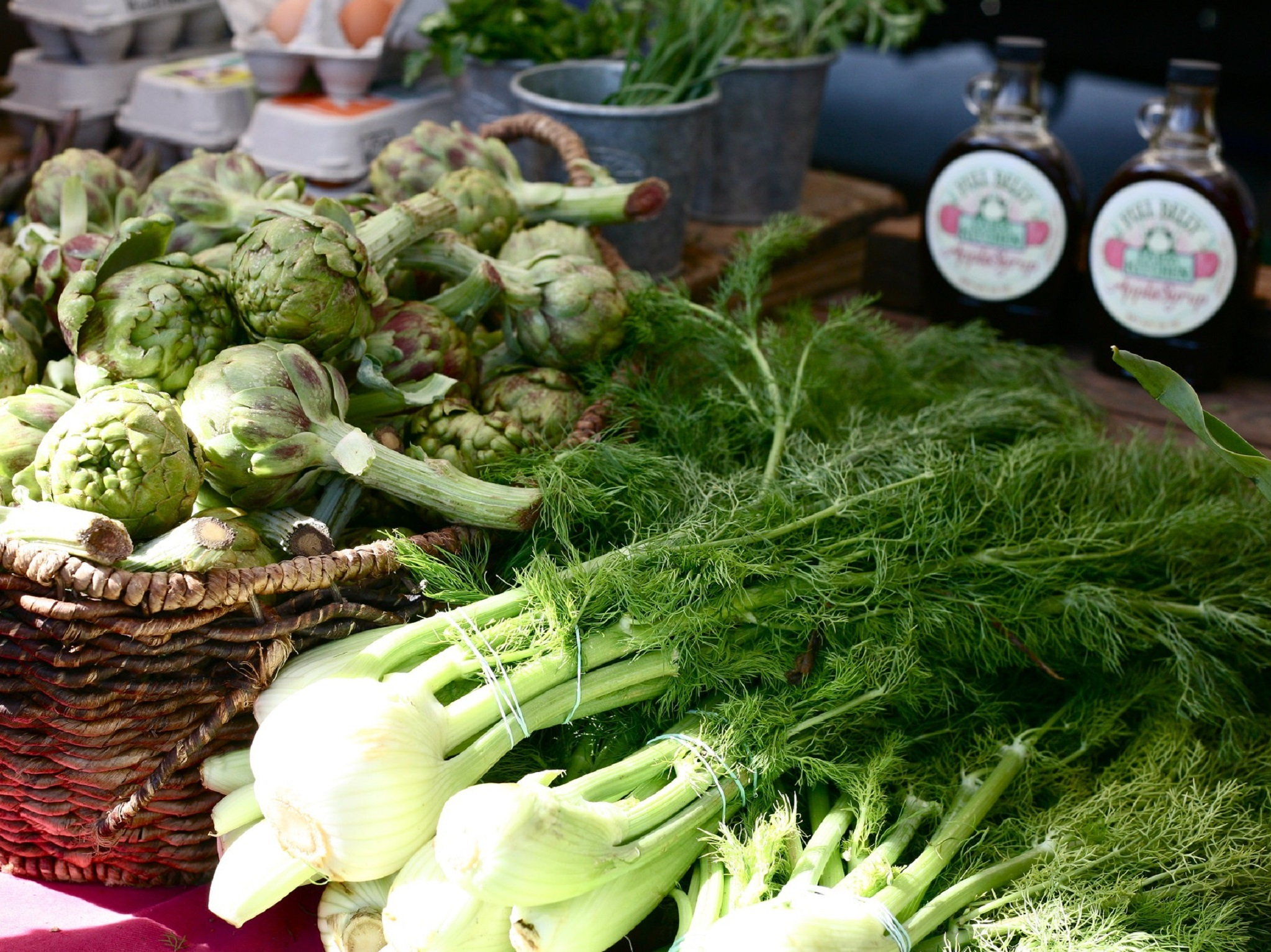 Fennel and artichokes on a farmers market table