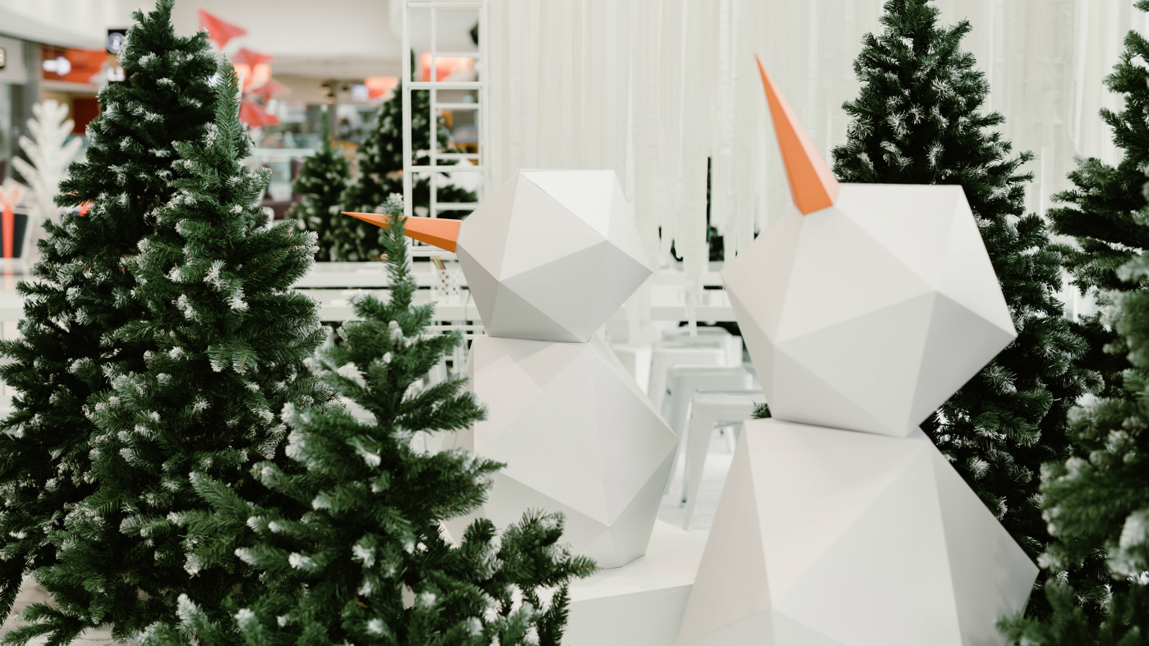 Snowy Christmas trees with geometric snowmen