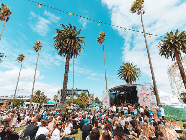 Crowd and palm trees at St Kilda Festival