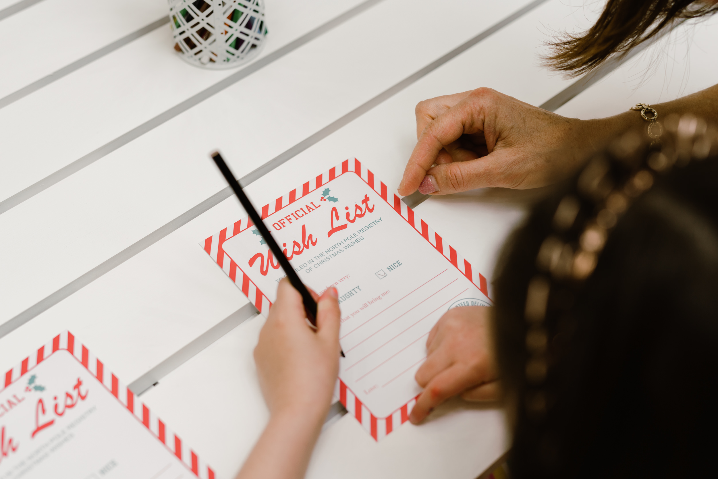 Girl writing santa letter