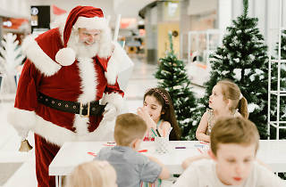 Santa saying hello to kids crafting