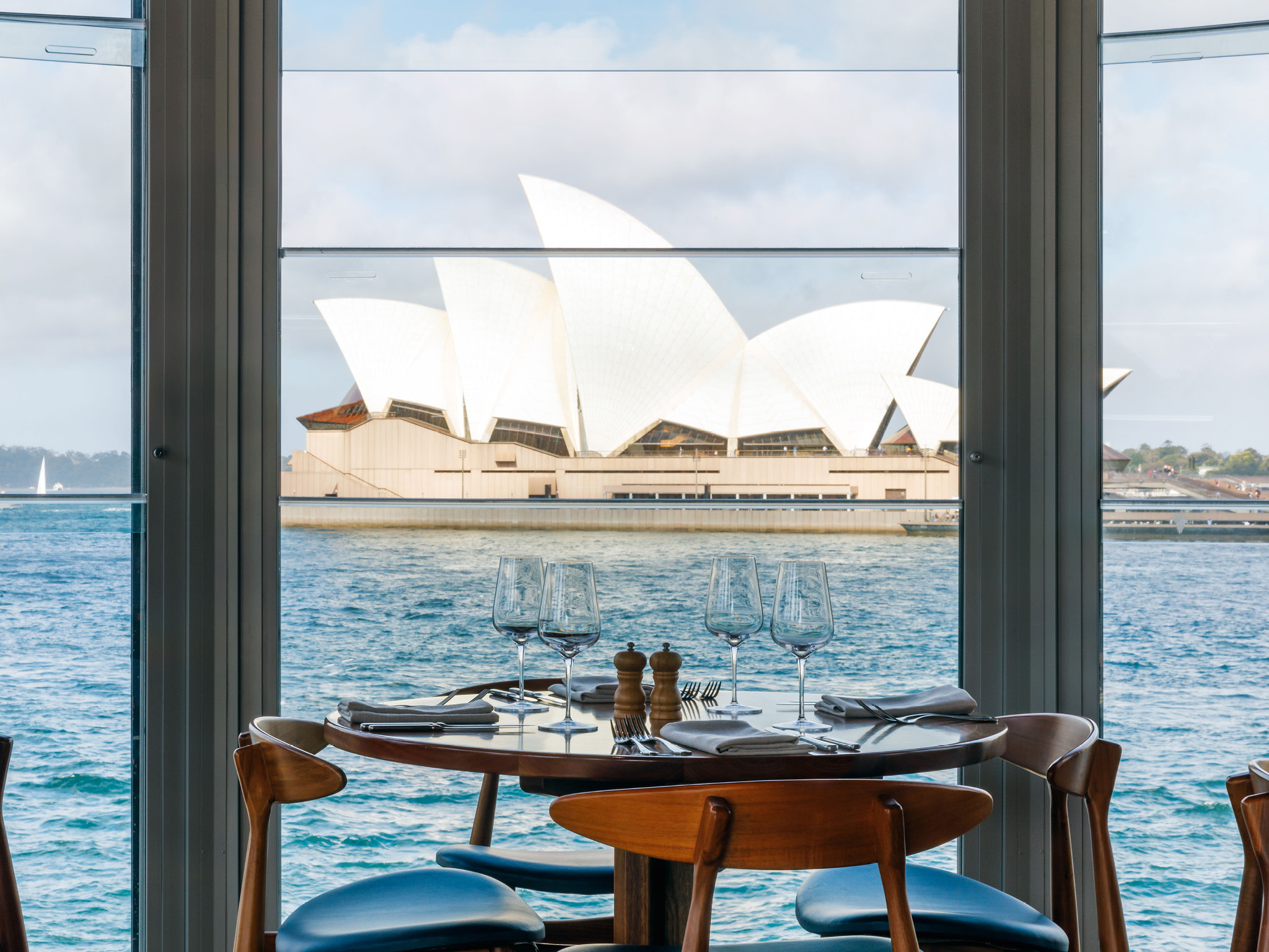 A restaurant table overlooks the Sydney Opera House.