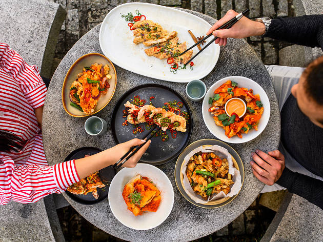 A birds eye view of a table laden with Chinese dishes.