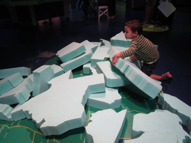 A kid playing with foam states