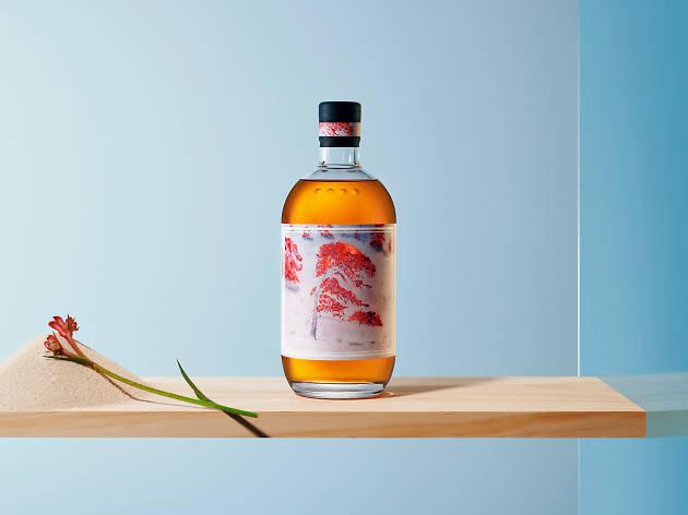 A bottle of amber gin on a shelf