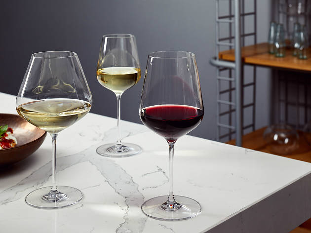 Three different wine glasses on a wine table