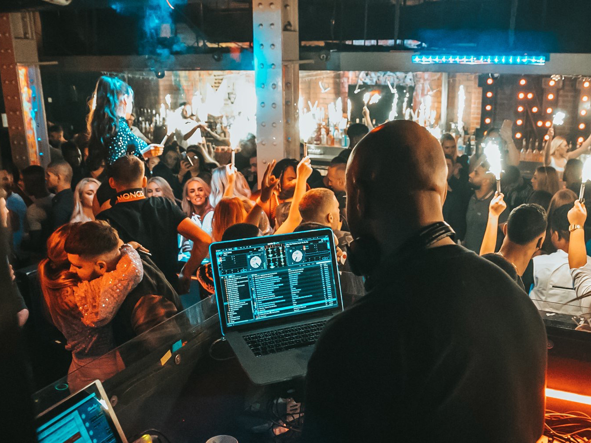 A DJ and crowd at Ink Bar club in Liverpool