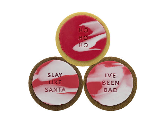 Round cookies with Christmassy slogans stamped into the icing