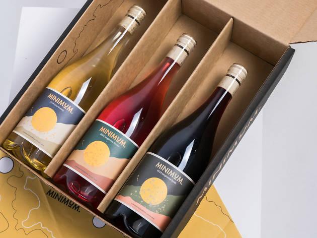 Three wines bottles in a cardboard box