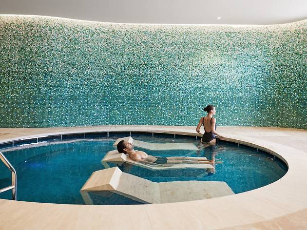 A couple relax in a hammam pool.