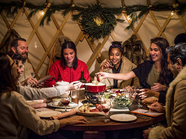 Have a fondue feast in a cozy winter yurt at the Standard East Village