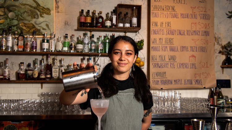 Atlanta Pahulu pouring a cocktail at Bulletin Place