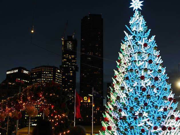 A 16 metre electronic Christmas tree glowing blue and white at night