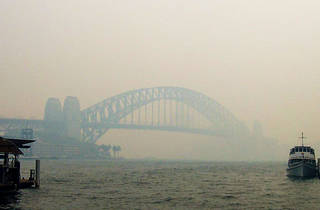 Boat on Sydney Harbour covered in smoke