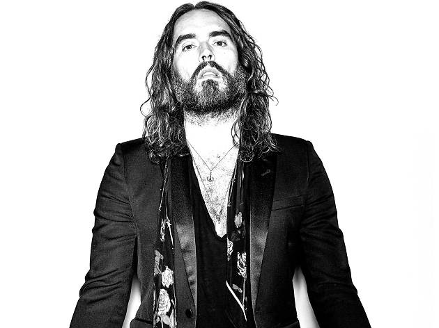 Russell Brand in black-and-white posing for his new show, Recovery Live.