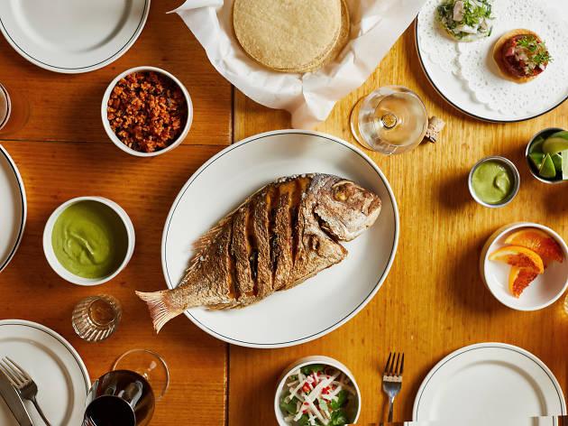 Big snapper fish among other dishes at Mamasita