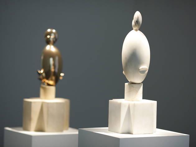 Constantin Brancusi, Blond Negresse, 1926 (left) and White Negresse, 1923 (right)