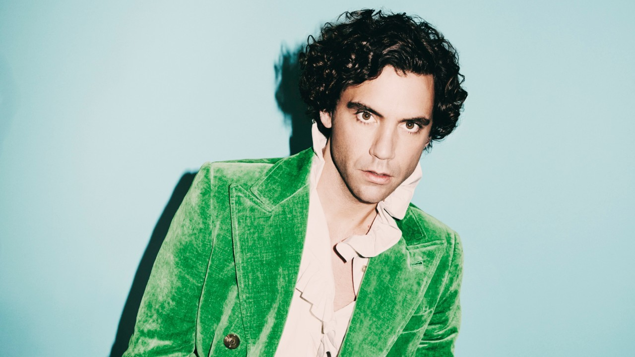 Press shot of pop artists Mika in a green suit.