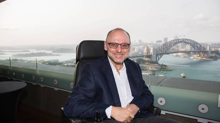 Accessibility advocate Max Burt overlooking Sydney Harbour.