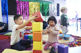 Kids playing with blocks.