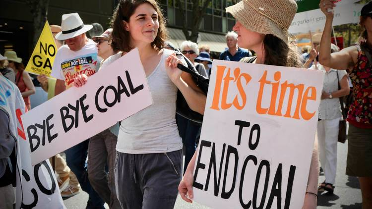 Protesters with signs at Sydney Climate Protest