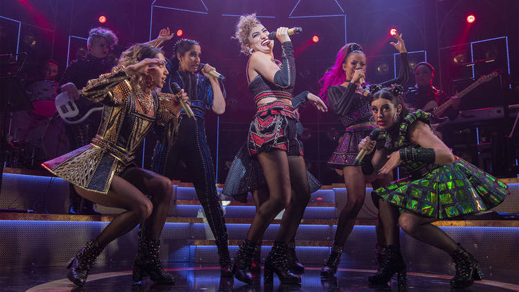 singers and dancers dressed as app band version of the the six wives of Henry VIII in Six the Musical