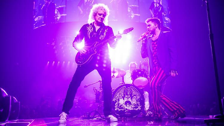 Adam Lambert on stage with Queen