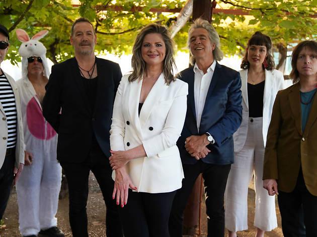 Julia Zemiro, Dugald McAndrew, Brian Nankervis and more people standing underneath a grape vine trellis