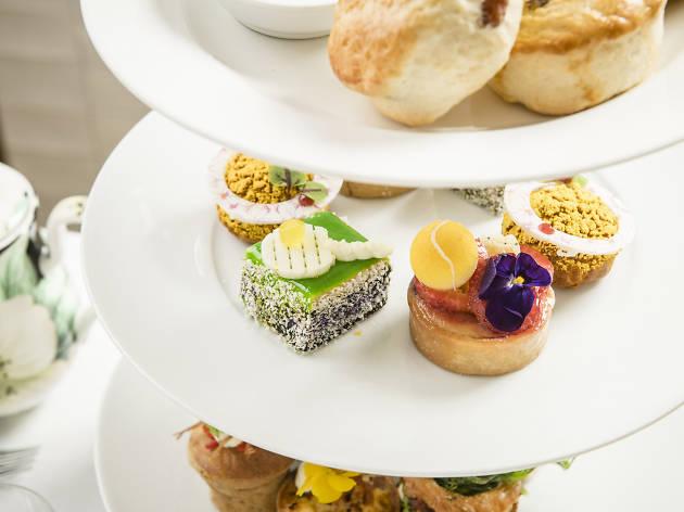 Tennis inspired high tea treats on platter.