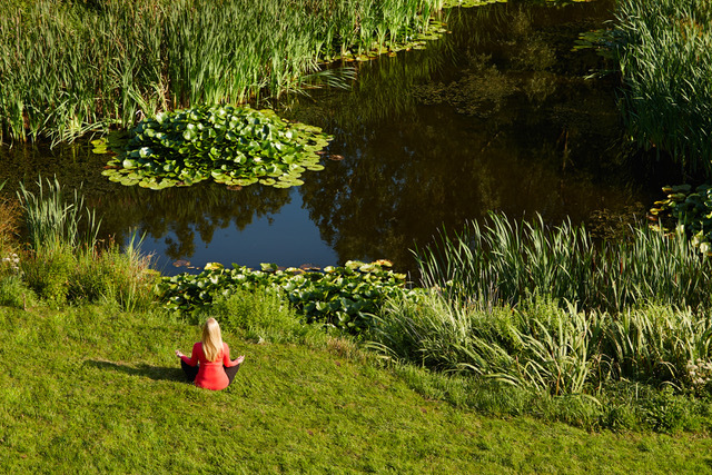 Meditating by the lake at Clover Mill, yoga retreat, UK