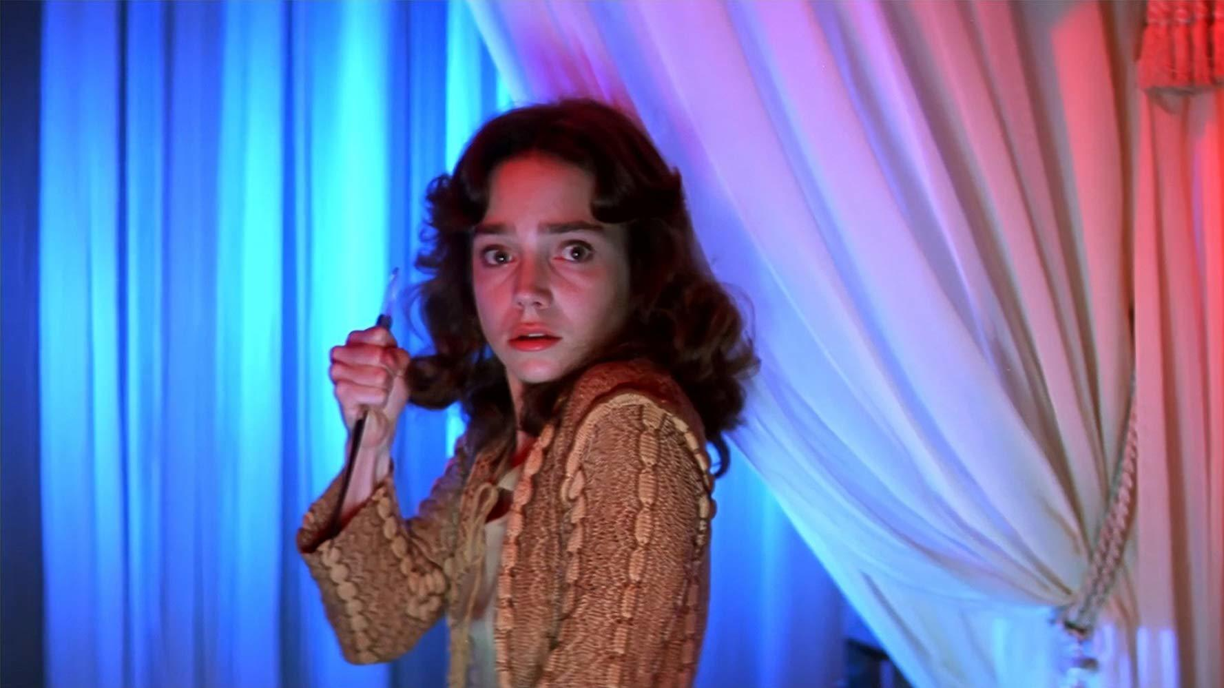 Women holding knife, still from Suspiria (1977)