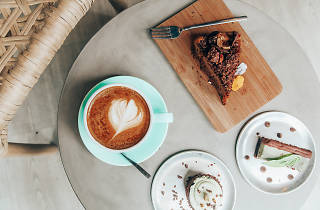 Coffee, cake and a slice on a table at PeanutButterLove