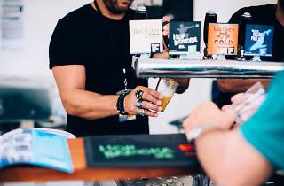 Bartender serving beer at festival