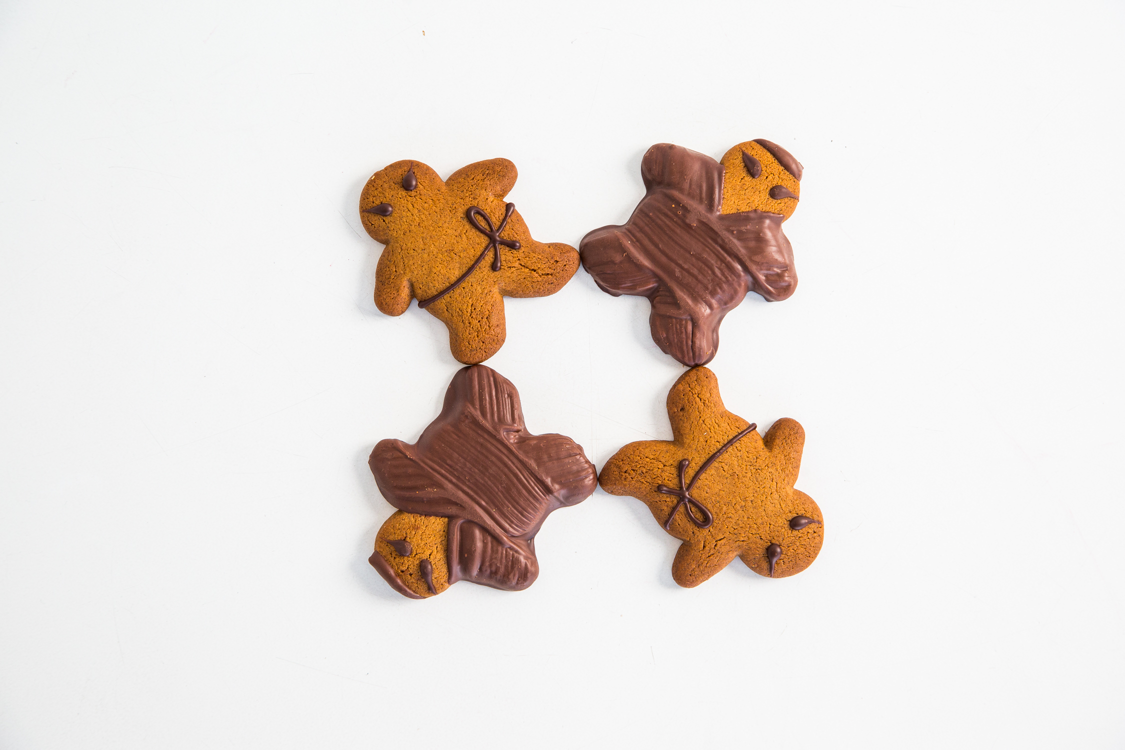 Four ginger ninja cookies against a white background