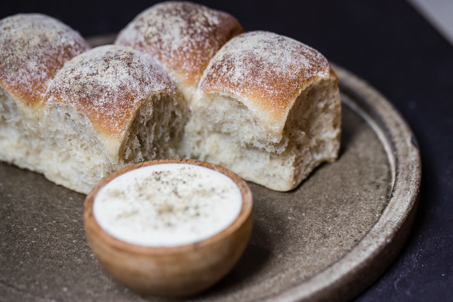Bread rolls on a plate with butter