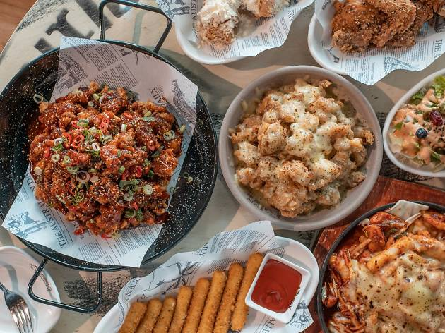 Flat lay of fried chicken and other dishes at Chicken V