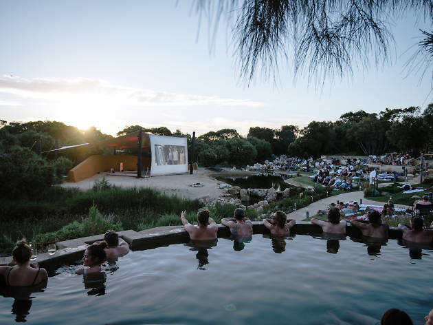 People watch a film from a hot spring