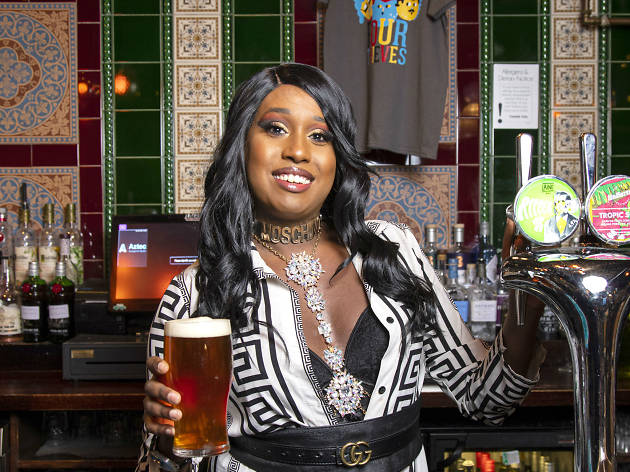 Woman smiling holding a pint