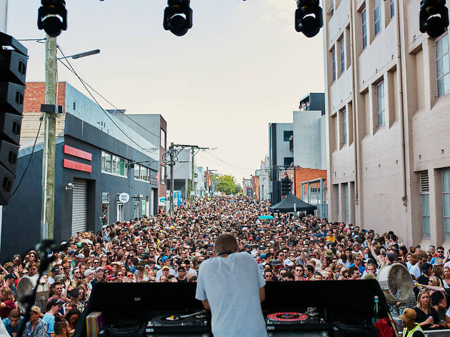 DJ playing in a street filled with people
