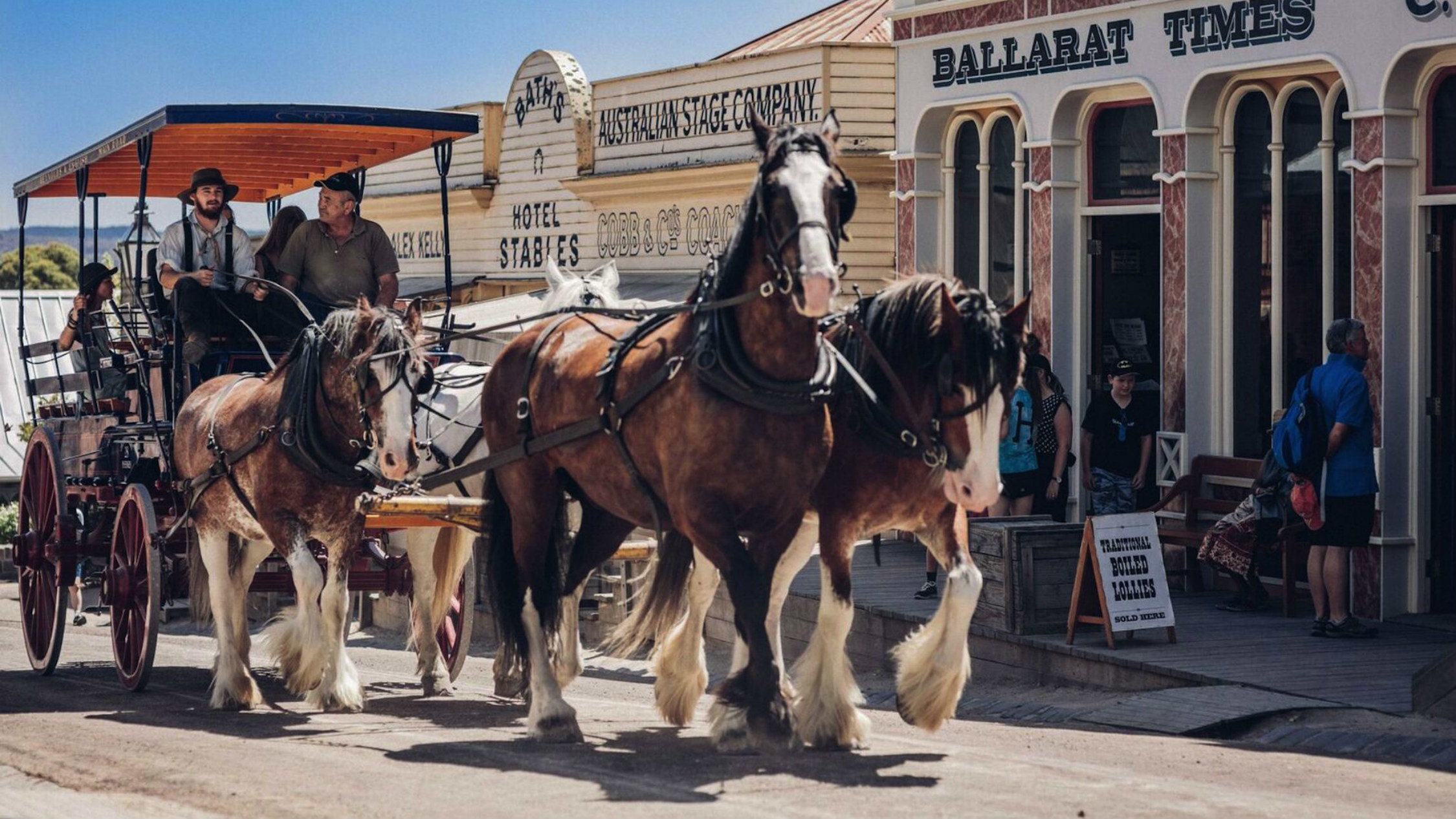 Drysdale horses pulling along a horse and cart at Sovereign Hill
