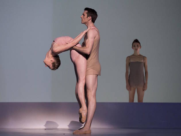 Two ballet dancers with a spotlight on them