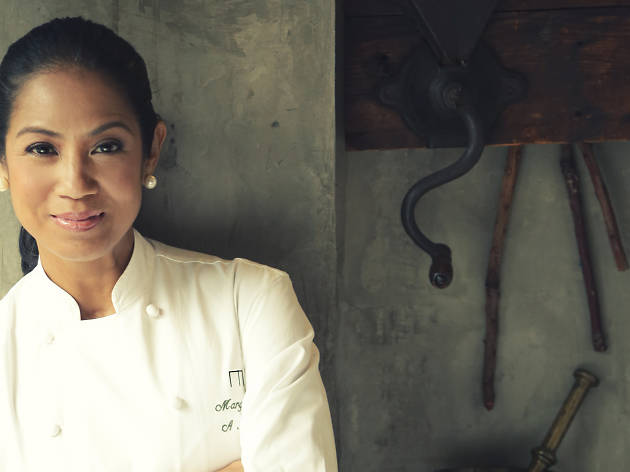 A portrait of chef Margarita Fores leaning against a wall
