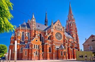 Osijek's shrub-lined Church of St. Peter and St. Paul