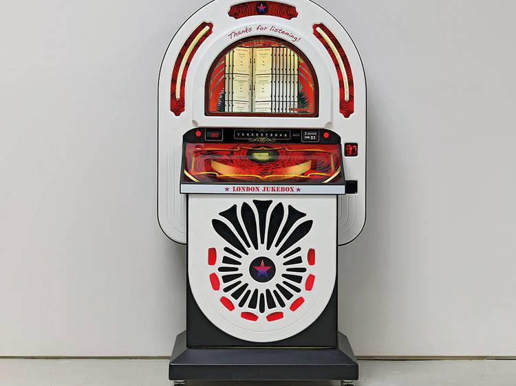 Uma jukebox com a banda sonora da cidade