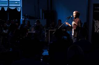 A slam poet performs